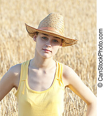Cowgirl on wheat field