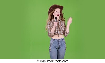 Cowgirl sings country songs and flirts with listeners. Green...