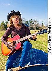 cowgirl, verticaal, het zingen