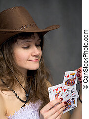 Cowgirl with a playing-cards in hand
