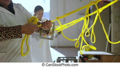 Coworker working in rope making industry 4k - Side view of ...
