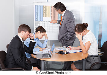 Coworkers Getting Bored At Presentation In The Office