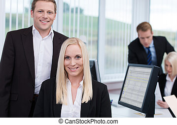 Coworkers in a busy corporate office