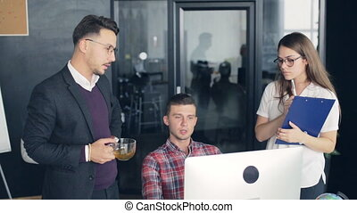 Coworkers in a modern office working on project in company
