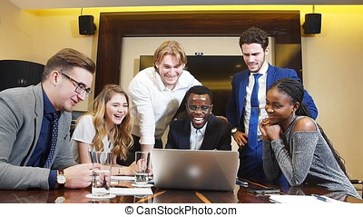 Coworkers Laughing Together During A Meeting.
