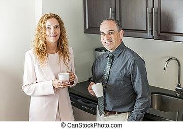 Coworkers on coffee break - Two office coworkers on coffee...