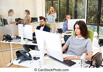 Coworkers working together in office