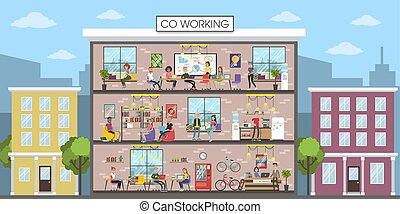 Coworking building interior. People working together at...