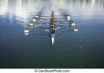 Coxed octosyllable - Boat coxed eight Rowers rowing on the...