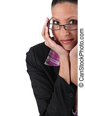 Coy brunette wearing glasses