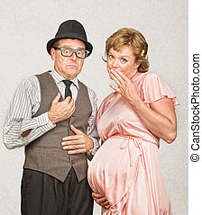 Coy Pregnant Couple - Embarrassed European male next to...