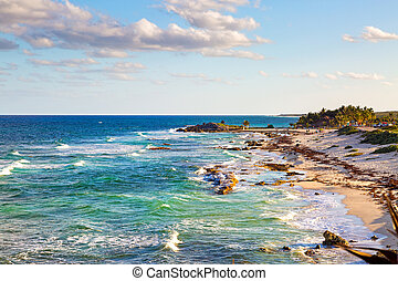Beautiful scenic high view of waves on the blue and turquoise color Caribbean sea in Cozumel Mexico