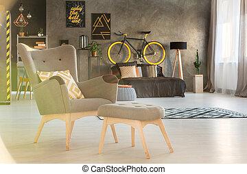 Cozy armchair in modern bedroom