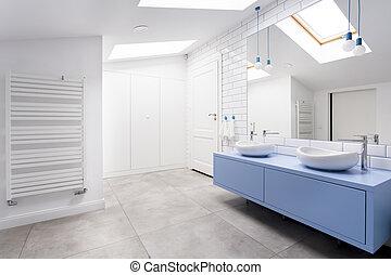Cozy attic bathroom with window