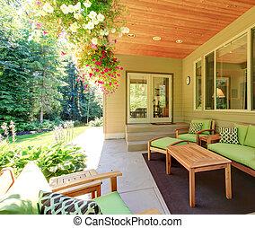 Cozy backyard concrete floor patio area with table set.