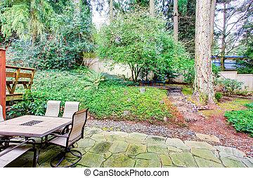 Cozy backyard overlooking green garden