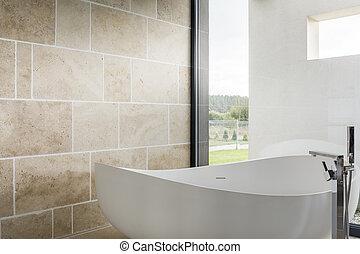 Cozy bathtub in a bathroom