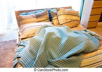 A Cozy And Warm Bed In Domestic Bedroom With Big Window