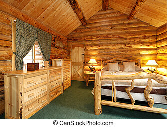 Cozy bedroom in log cabin house