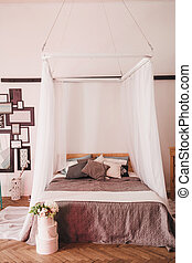 bedroom with a four-poster bed