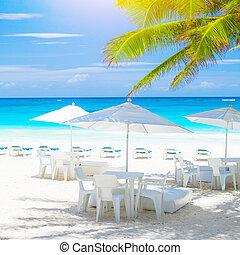 Cozy cafe on sea shore