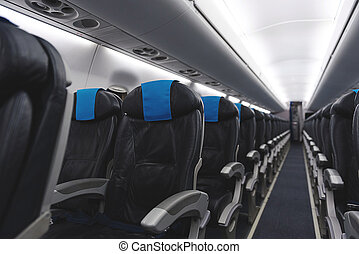 Cozy chairs situating in plane - Focus on interior of ...