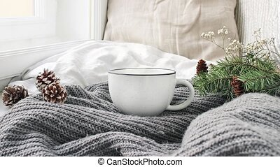Cozy Christmas morning breakfast in bed scene. Steaming cup...