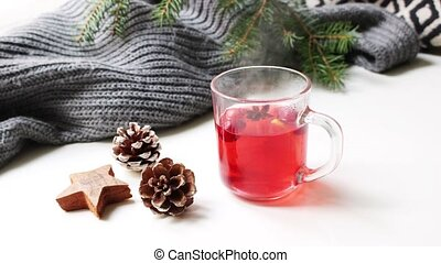 Cozy Christmas morning breakfast scene. Steaming glass cup...