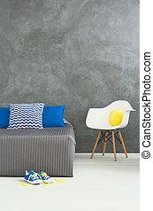 Cozy corner in grey bedroom