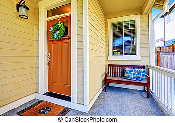 Cozy covered porch Close-up with wooden bench.