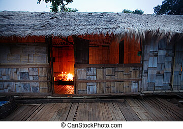 Bamboo hut with fireplace on inside & grass roof