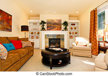 Cozy furnished living room with sofa and fireplace