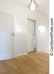 Cozy hallway with white walls, wooden floor and designer ...