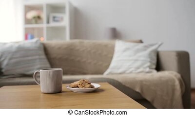 chocolate oatmeal cookies and mug with hot drink