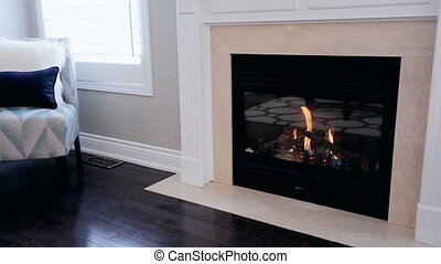 Cozy Home Fireplace - Cozy fireplace inside a home with a...