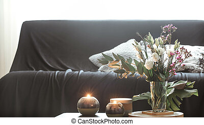 Cozy home interior living room with a vase of flowers and candles