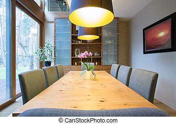 Cozy illuminated dining room in modern design