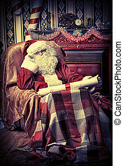 cozy interior - Santa Claus with a list of Christmas ...