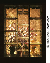 Cozy light seen through the glass window