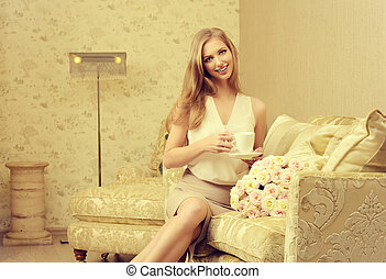cozy living-room - Charming young woman in a room with...