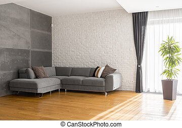 Cozy living room with sofa - Cozy, grey living room with...