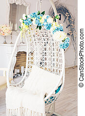 Cozy oval white chair in a bright room