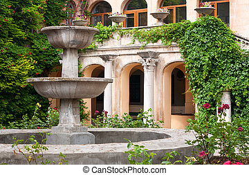 Cozy patio with small garden in museum of Chersonese. Sevastopol, Crimea