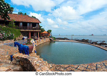 Cozy resort with swimming pool by the sea