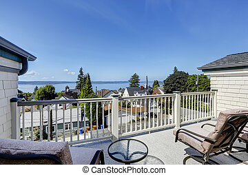 Cozy walkout deck with sitting area. Deck overlook scenic bay view