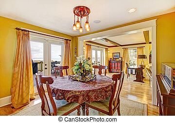 Cozy yellow dining room