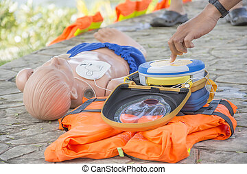 CPR and AED training child dummy drowning case hand puch shock button