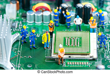 CPU Repair - Group of miniature engineers inspecting...