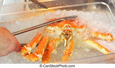 Crab being prepared by chef in kitchen