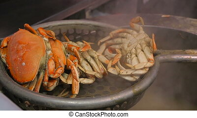 Crab boiling in a big pan. - Crabs cooking in a big...